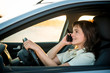 Woman driving car on phone