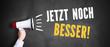 """Megafon vor Kreidetafel mit Slogan """"Jetzt noch besser"""""""