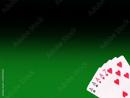 Four of a Kind playing cards on the poker table плакат