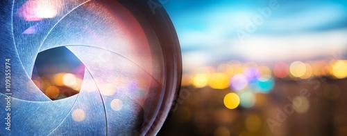 Photo Camera lens and city light