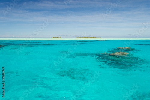 Shallow coral reef in turquoise transparent water, Aitutaki, Cook Islands