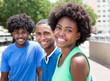 canvas print picture - Drei sympathische afrikanische Jugendliche in der Stadt