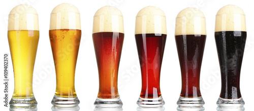 Vászonkép  Different types of beer in glasses, isolated on white