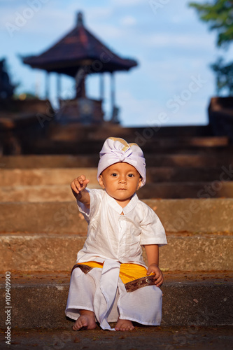 Portrait Of Balinese Baby Boy With Smiling Face In