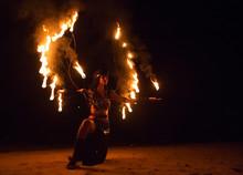 Fire Show Artist On The Beach Fire In The Dark