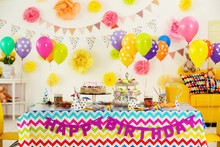 Colorful Dessert Table With De...