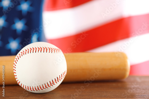 Photo  Baseball and bat on background of American flag