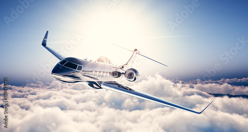Photo of black luxury generic design private jet flying in blue sky. Huge white clouds and sun at background. Business travel concept. Horizontal. 3d rendering