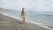 St. Kitts beach. Bikini girl tourist walking on popular beach on Saint Kitts and Nevis after swimming and relaxing enjoying Caribbean Cruise ship destination. Shot on RED EPIC.