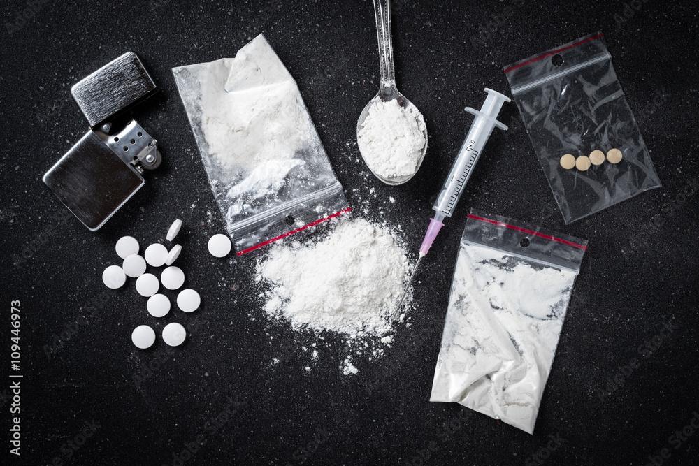 Fototapeta Hard drugs on dark table