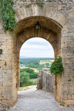 Medieval Doorway Leading to Tuscan Countryside in Italy - 109454790