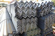 Steel Angles. Stuck Og L-beams On The Warehouse. Metal Rolled Angle Bar.