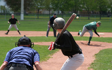 The Pitcher Has Just Released The Ball, The Batter Is About To Swing.