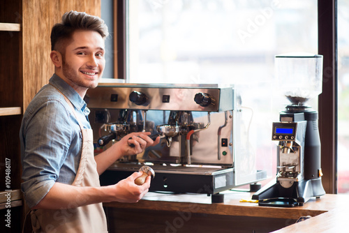Fotografie, Obraz  Pleasant barista working in the cafe