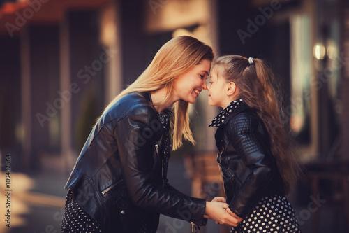 Fototapeta young beautiful woman with her little cute daughter obraz na płótnie