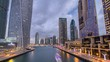 View of Dubai Marina Towers and canal in Dubai day to night timelapse