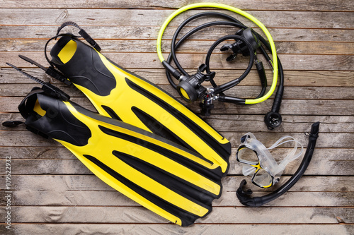 Fotografie, Obraz  Mask, fins, snorkel and regulator on wooden desk