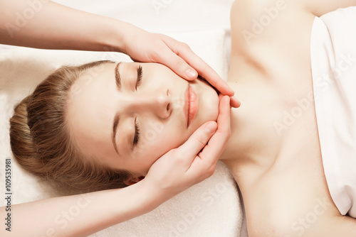 Spa. Woman enjoying anti-aging facial massage