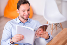 Pleasant  Smiling  Man Reading...