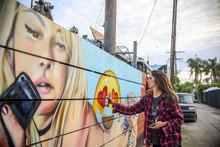 Graffiti Artist Spray Painting Wall On Street, Venice Beach, California, USA