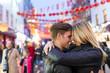 Romantic young couple hugging, Chinatown, London, England, UK