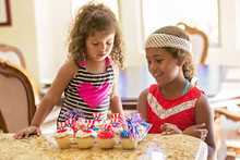 Girls Looking At American Flag Theme Decorated Cupcakes