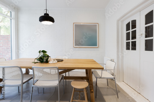 Modern scandinavian styled interior dining room with pendant lig Poster