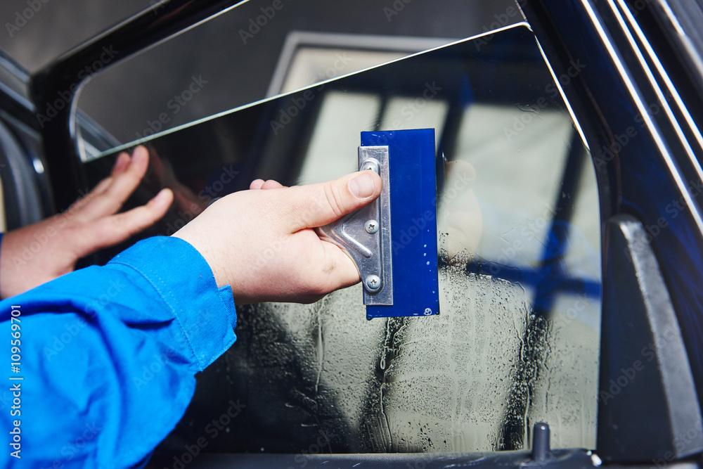 Fototapety, obrazy: car tinting. Automobile mechanic technician applying foil