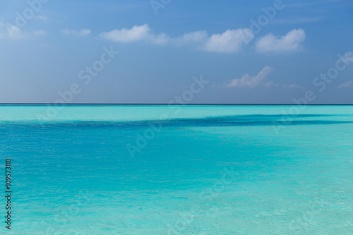Wall Murals Green coral sea and sky on maldives beach