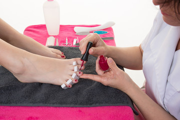 FototapetaCloseup photo of a female feet at spa salon on pedicure procedure.