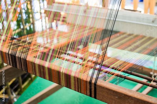 Fotografie, Obraz  Detail of weaving loom for homemade silk or textile production