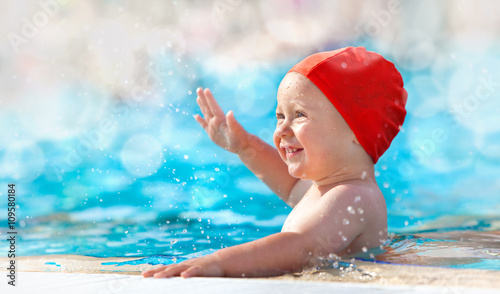 happy child with swimming pool cap have fun in a pool Wallpaper Mural