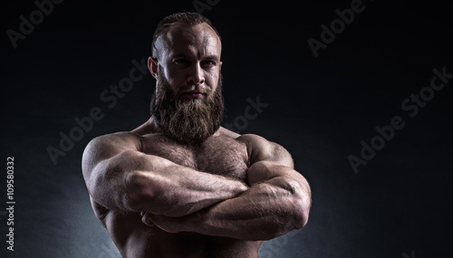 Fotografie, Obraz  Strong bearded man with perfect abs, shoulders, biceps, triceps