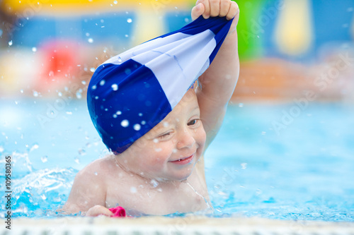 happy child with swimming pool cap have fun in a pool Canvas Print