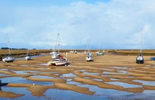 Boats At Low Tide On The North Norfolk Coast.