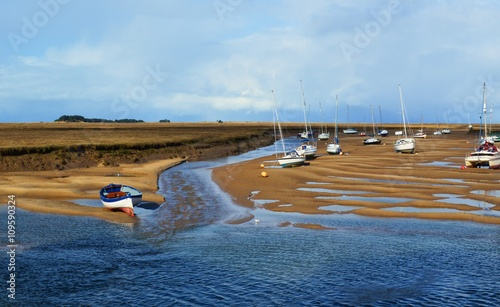 Stampa su Tela Boats at low tide on the North Norfolk coast.