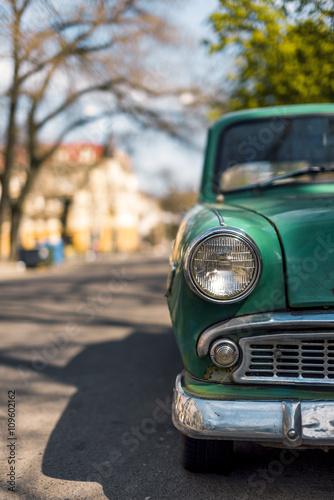 Green old car. © ardasavasciogullari