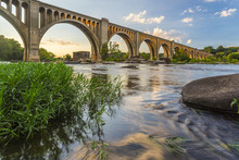 Richmond Railroad Bridge Lit By Sun/ The Graceful Arches Of A Railroad Bridge Spanning The James River In Virginia Are Illuminated By The Setting Sun.