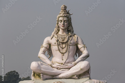 Hindu god Shiva sculpture sitting in meditation on Ganges river in Rishikesh, In Canvas Print