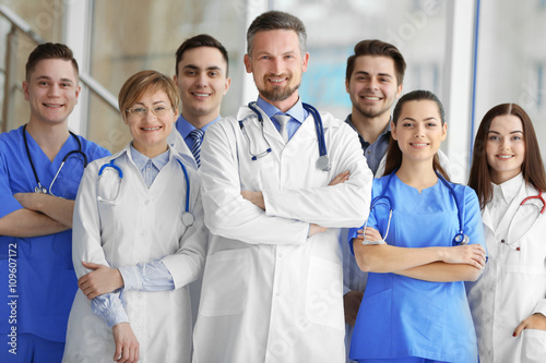 A group of doctors and nurses standing in the hospital - Buy this stock photo and explore similar images at Adobe Stock | Adobe Stock