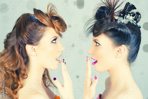 Photo  Absolutely Gorgeous Twins Girls with Fashion Make-up and Hairstyle