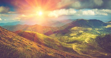 Fototapeta Vintage Beautiful panoramic mountain landscape at sunset.