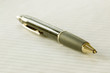 Closeup of a pencil on a writing pad