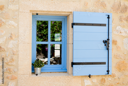 blue old window in traditional french provence architecture