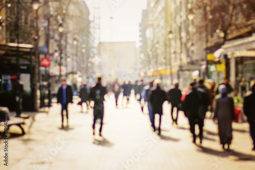 Fotografie, Obraz  Blurred background. Blurred people walking through a city street