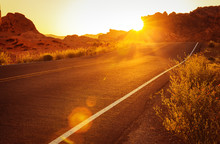 Red Sunset Over Road In Southern Nevada, Valley Of Fire State Park, USA