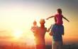 Leinwanddruck Bild - happy family at sunset.
