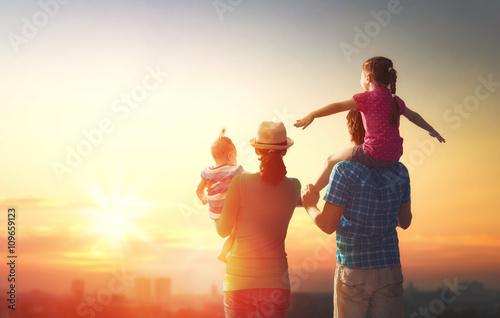 happy family at sunset.