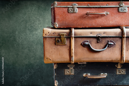 Staande foto Retro Vintage Stack Ancient Suitcases Concept Travel