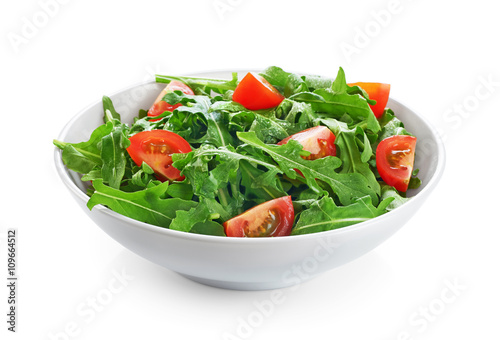 Bowl with fresh green salad arugula and tomatoes isolated on whi Wallpaper Mural
